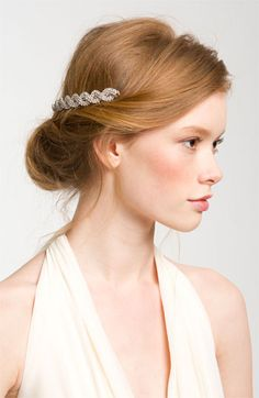 Love this chic rolled updo - topped perfectly with a simple accessory