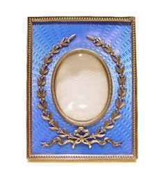 Fabergé: Enamelled silver gilt photograph frame by Carl Fabergé.  Workmaster Johann Viktor Aarne,   St. Petersburg, 1896-1904.