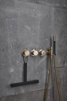 Beautiful pictures from the new Menu bath campaign. I like the combination of the grey natural stone with the brass taps, the matt black bathroom products and the delicate pink flower.
