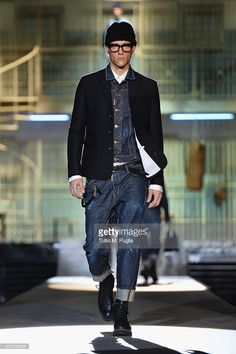A model walks the runway during the Dsquared2 show as a part of Milan Fashion Week Menswear Autumn/Winter 2014 on January 14, 2014 in Milan, Italy.