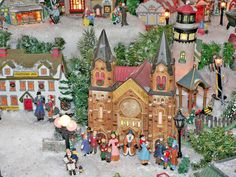 Churches, Carolers, Inns, Restaurants and Lighthouses are just some of the buildings on display in David Towne's Victorian Village. (Bea Pet...