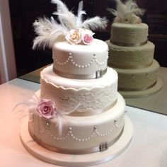 Great Gatsby Inspired Wedding Cake With Feathers Lace Diamante And Roses