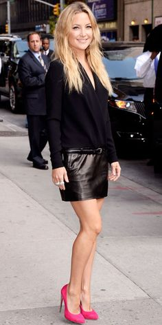 Kate Hudson exited The Late Show with David Letterman in a belted black dress and electric pink pumps.