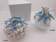 Bomboniere  Linea Traforata Profumatore, porta essenze in porcellana Traforata e stelle Marine Blù Tiffany.