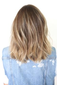 One length below the shoulders - wavy hair