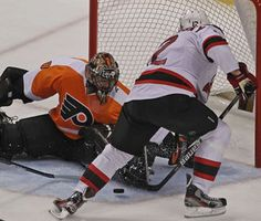 Ilya Bryzgalov prevents a goal by New Jersey's Alexei Ponikarovsky in Game 2 at the Wells Fargo Center.