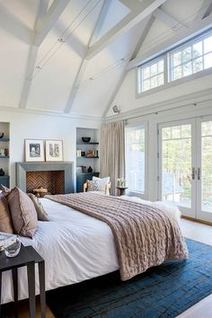 What a fabulous room! The light from the windows, the fireplace, the use of the blue in the rug...love! #staging #bedroom liked@ stagedtodaysoldtomorrow.com