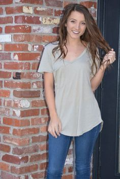 Perfect Pocket Tee in Aluminum Favorite tee is an understatement. Made from our signature burnout jersey, this tee is complete with a curved v-neckline and a slouchy raw edge pocket. Because of its so