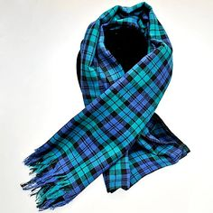 This typically Scottish Tartan scarf is made to the Black Watch design registered at the Scottish Tartan Registry. It's woven in a fine classic twill weave from 100% pure cotton and suited equally to both men and women.  At a full 80cm wide it also makes a great pashmina.  Imported from India by a BAFTS Registered Fair Trade importer.  Length : 180cm Width : 80cm
