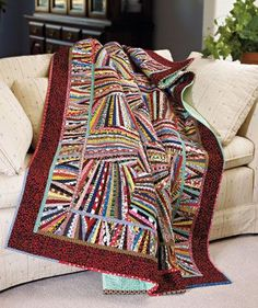 This is such a fun quilt to look at and to make! Plus, you get to dive deep into your fabric stash. #ScrapQuilts #ScrappyQuilts #ScrapQuiltPatterns