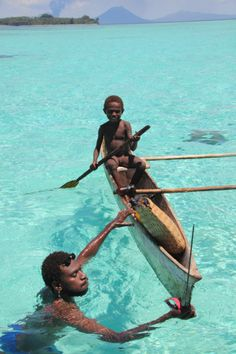 Father and son fishing in East New Britain Province, Papua New Guinea. www.papuanewguinea.travel/eastnewbritain