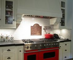 Light Cabinets, Dark slate counter, and a RED STOVE!!