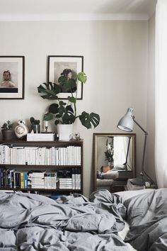 Bedroom with bookshelf. Paintings by Kai Samuels-Davis