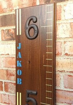 Wooden Growth Chart With A Custom Name And Stripes by LightFilled, $69.99