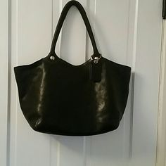 """Coach handbag Large black Coach handbag. This was my first ever Coach bag. I bought her second hand but took very good care of her. Always wiped off before storage and stored stuffed. Hang tag worn but still present with original brass ball chain. Slight wear to the leather along the top edges of the bag but certainly does not affect use. Bag measures 19.5"""" across the widest part of the top of the bag by 11"""" high by 4.5""""deep. A wonderful bag with so much life left. Coach Bags Satchels"""