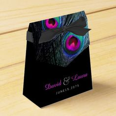Beautiful teal blue and hot pink peacock wedding favor boxes. You can personalize this elegant royal, teal blue and hot pink peacock feather wedding favor box with your text in the font style you like, add a background color and change the ribbon color.
