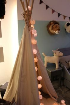 Teepee play tent (Mj would love), i love the stuffed animial heads on the wall!