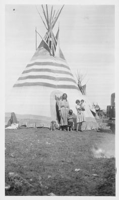 A Blackfoot tipi with traditional painted lodge design. No date, location, or additional information.