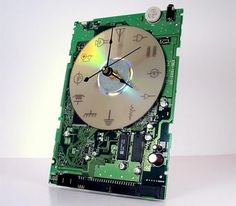Laser etched clock where the numbers have been replaced by a variety of schematic and logic symbols