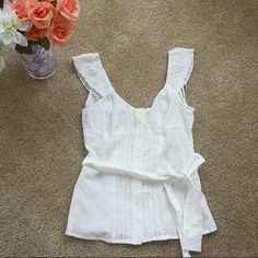 Bohemian White Button Up Tank Top Bohemian white button up tank top from Guess. Sheer. Tie front. Flutter sleeves. Runs small, tag shows small, but fits an X Small.   No trades.  No paypal. Instagram: @Jhennay262 Guess Tops Button Down Shirts