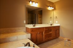 Couples will appreciate dual vanities in the master bathroom. The Trinity #1304. http://www.dongardner.com/house-plan/1304/the-trinity. #MasterBathroom #Bathroom #DualVanities