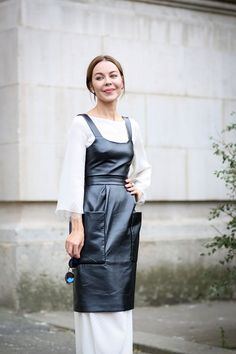 80 French Style Lessons To Learn Now #refinery29  http://www.refinery29.com/2014/10/75565/paris-street-style-photos-fashion-week-2014#slide-54  Do: Layer a leather dress over anything.