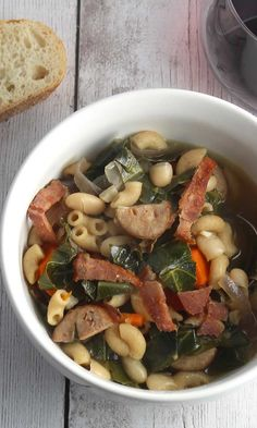collard greens, chicken sausage, beans and turkey bacon provide healthy substance in this comforting soup recipe. #soup #healthyeating #greens