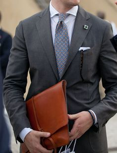 omg... mlutch (man clutch) love~  Street Style: The Top 7 Trends from Spring 2014: Rules of Style