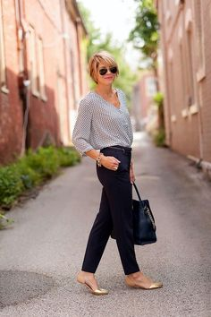 Summer office idea. Long sleeve blouse to fight chill of A/C, classic cut  dark pants, with a stylish gold flat.