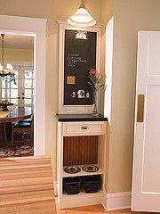 Built in food bowls.  A must for when we redecorate the kitchen !  How bout chalkboard paint with molding around it to make it look like a board that was put there!