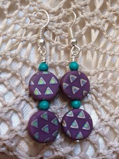 Turquoise and purple pendant earrings by Momsawrapstar on Etsy https://www.etsy.com/listing/231589506/turquoise-and-purple-pendant-earrings