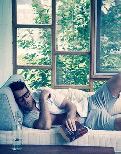 No clue who this is, but he's sexy and he's reading (at least for the photo shoot.) Where are all the guys like this?