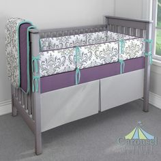 Crib bedding in Solid Aubergine Purple, Gray Traditions Damask, Solid Teal, Silver Gray Minky. Created using the Nursery Designer® by Carousel Designs where you mix and match from hundreds of fabrics to create your own unique baby bedding. #carouseldesigns