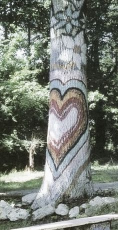 Heart {colorful} painted on tree trunk. Nice in yard. Heart art on tree!