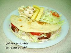 A delicious middle-eastern take on a sandwich made of pita bread and a filling of chicken kababs.