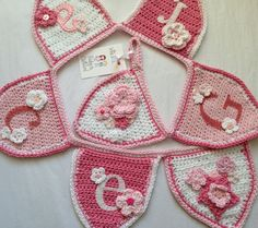 Pink flowers crochet name bunting by rubyandcustard.com