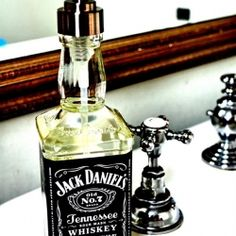 Recycle an old Jack Daniel's whiskey bottles, and give them new life as a soap dispenser.