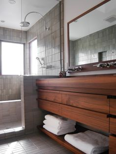 Wood Vanity and Clay Tiles from Heath Ceramics -- watery bathroom design interior interior design decorating before and after Bathroom Tile Designs, Bathroom Renos, Modern Bathroom Design, Bathroom Interior, Bathroom Vanities, Bathroom Ideas, Wood Bathroom, Mirror Bathroom, Bathroom Storage