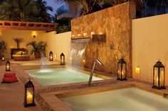 Relax in the whirlpools in the outside area of the spa at Sunscape Dorado!