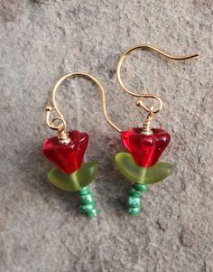 so pretty delicate red rose flower glass seed bead dangle drop beaded handmade earrings. $7.00, via Etsy.