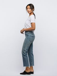 """An employee favorite! Versatile and comfortable, FashionABLE's The Vintage jean features a mid rise, slight distressing, fading, five pocket design, and a raw hem. *Fabric: 75% Cotton and 25% Lyocell *Sizing: 27"""" inseam with a 9"""" rise *Style Tip: The perfect vintage boyfriend jean, pair with a sweater and sneakers or booties for an effortlessly chic look!"""