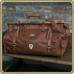 Americana style handcrafted leather travel bag. Unique design features solid copper tubing and brass fixtures. Pommel Shield & adjustable shoulder strap.