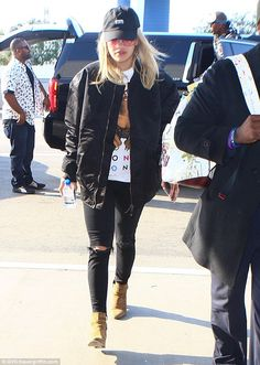 Laid-back lady: Rita cut a casual figure as she completed her ensemble with a pair of blac...