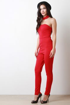 Choker Tube Top Jumpsuit. Description This  jumpsuit  features a tube neckline, choker neck, zipper racer back, high waisted cinched seam, and taper cut legs. Accessories sold separately. Made in U.S.A. 63% Rayon, 32% Polyester, 5% Spandex.  Measurement   Size Bust Waist Hip Length Sleeve   S 14 13 15 56 27.5   M 15 14 16 57 28   L 16 15 17 58 28.5