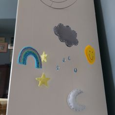 handmade felt and crystal weather mobile (or sun catcher!). features and embroidered rainbow, a sequined smiling sun, a stormy grey rain cloud with crystal rain drops, a beaded crescent moon and sequined yellow stars. handmade to order so you can customise your mobile at www.anniemadeit.com