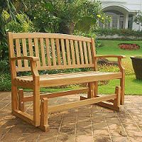 Back porch between the two master bedroom windows.   Teak Glider Bench - Sam's Club