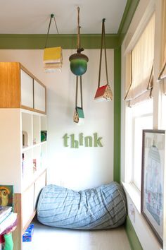 Green trim, reading nook, books hanging from ceiling