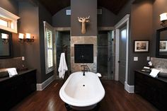 A man's bathroom--very strong but simple, the dark colors with the bright white trim and tub.
