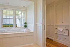 Really love the woodwork on the side of the bathtub and the built-in cabinets out in the hall