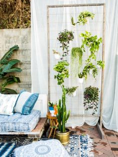 Even if you have a small deck or patio, you can still enjoy lots of lush greenery. Take advantage of vertical space by hanging potted plants from this DIY living wall. As the plants grow, they'll also provide privacy for your outdoor living area. Hanging Potted Plants, Patio Plants, Outdoor Plants, Outdoor Spaces, Outdoor Living, House Plants, Plants Indoor, Indoor Gardening, Organic Gardening